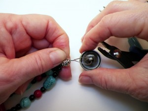 fastening the button to the bead wire
