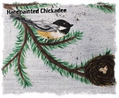 a couple of chickadee's handpainted on a wooden block