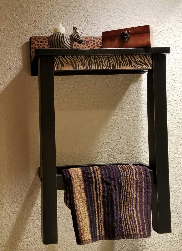 Repurposed wood chair turned shelf