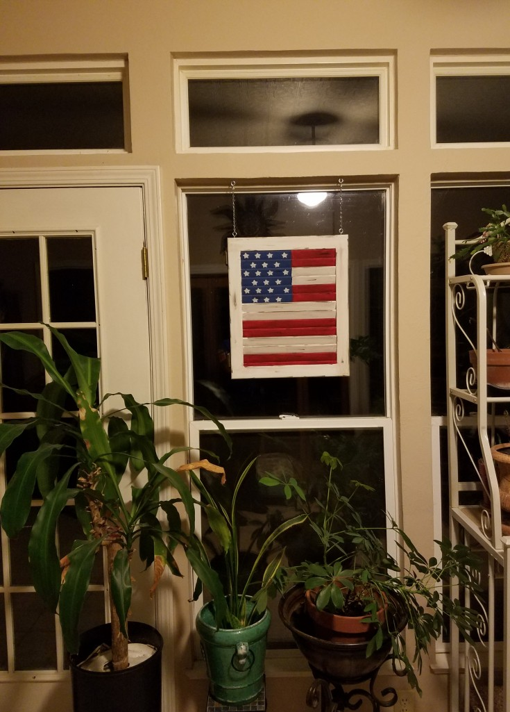 American flag made from a wood shutter