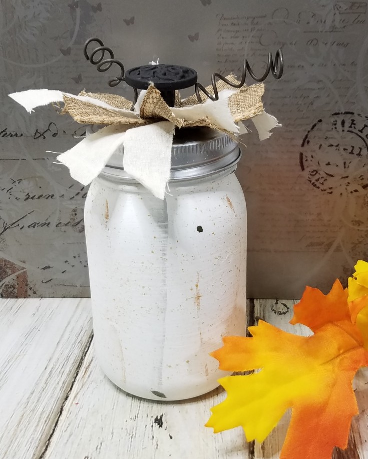 white pumpkin jar