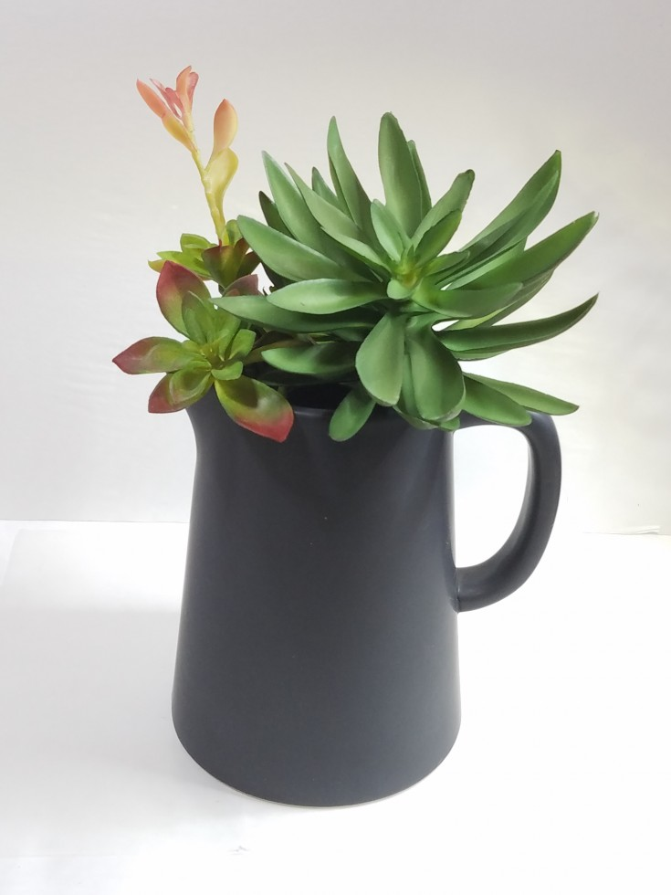 how to make an easy diy faux succulent planter out of a pitcher