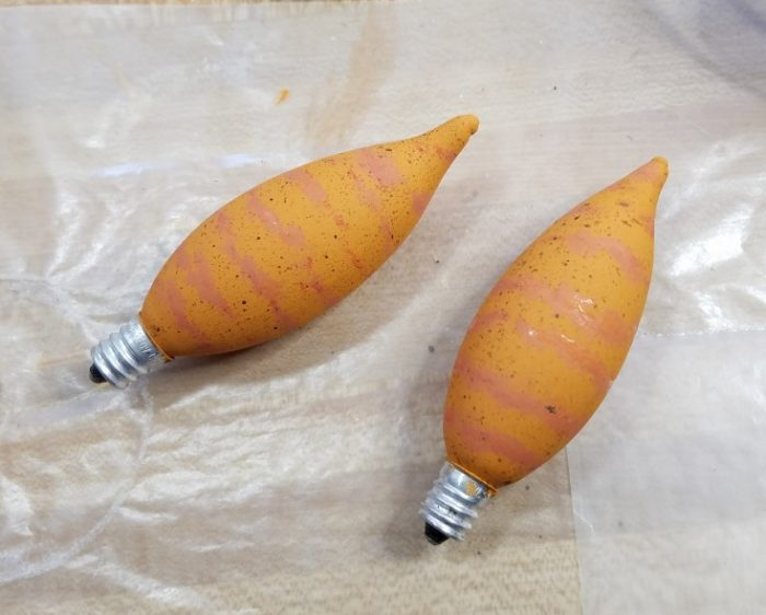 How to make Upcycled Light Bulb Carrots for Easter Decor out of used chandelier bulbs MixedKreations.com