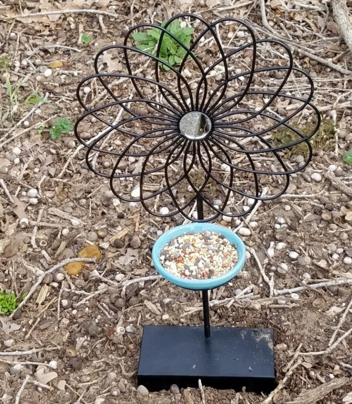 how to upcycle a thrift store candle sconce into a bird feeder