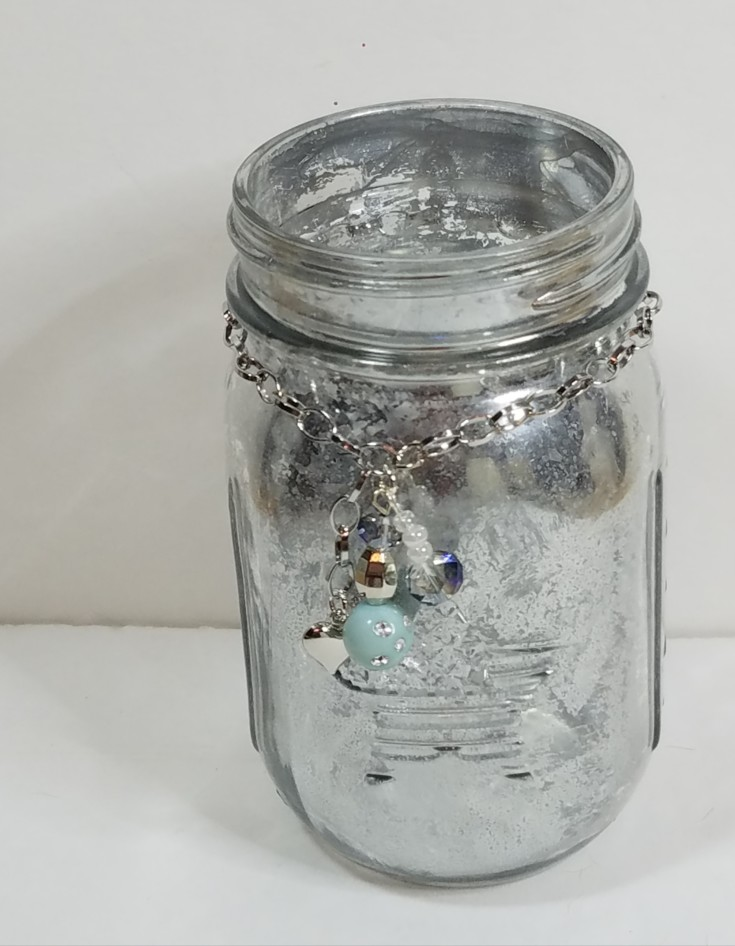diy mercury glass jars, upcycle a glass jar with looking glass spray paint